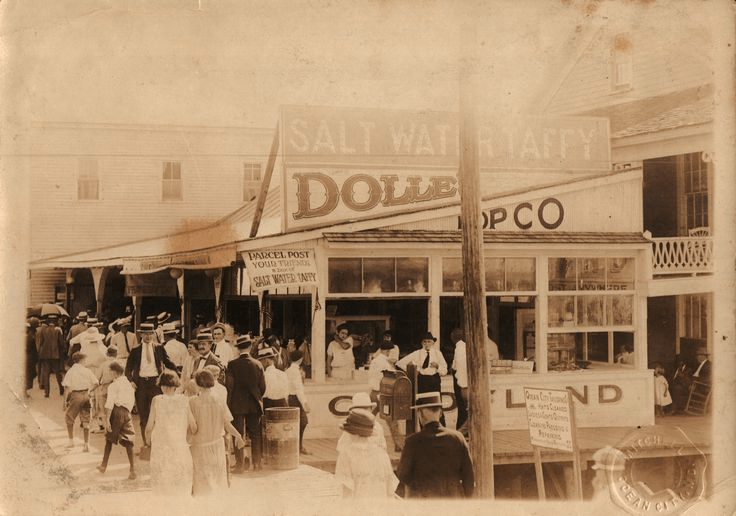 People in line to get saltwater taffy in 1920